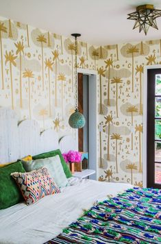 Resort-style decor is in, as proven by Justina Blakeney + her Hygge & West Cosmic Desert wallpaper!