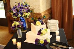 Wedding cake and bouquets...peacock theme