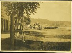 Covered Wagons on Front Street, Quesnel - Northern BC Archives