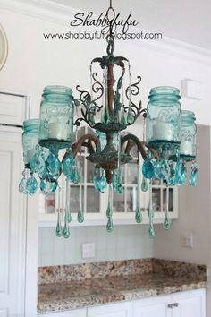 Mason Jar Lights - Turquoise Mason Jar Chandelier - DIY Ideas with Mason Jars for Outdoor, Kitchen, Bathroom, Bedroom and Home, Wedding. How to Make Hanging Lanterns, Rustic Chandeliers and Pendants, Solar Lights for Outside  http://diyjoy.com/diy-mason-jar-lights-lanterns