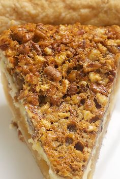 Pecan Cheesecake Pie Recipe ~ little layer of cheesecake adds a bit of unexpected creamy sweetness to traditional pecan pie.
