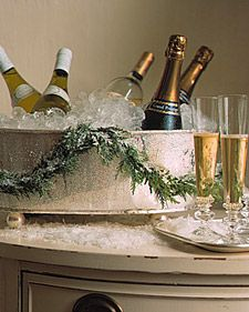 Beverages chill in a silver champagne cooler adorned with a flocked cedar garlan… - Noel - christmas Christmas Style, Noel Christmas, All Things Christmas, White Christmas, Christmas Crafts, Christmas Decorations, Christmas Arrangements, Southern Christmas, French Christmas