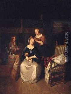 A lady seated in an interior with a spaniel on her lap, a servant tending her hair Oil Painting - Caspar Netscher