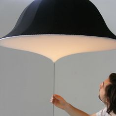 Etirement by Rémi Bouhaniche on Dezeen. The more you pull the rod, the brighter the light.