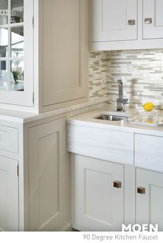 Our 90 degree faucet fits in seamlessly with the marble countertops and white cabinets of this impeccable kitchen.