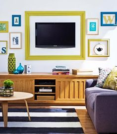 TV turned artwork  Make the TV blend into your decor by mounting it on the wall and adding a homemade frame.