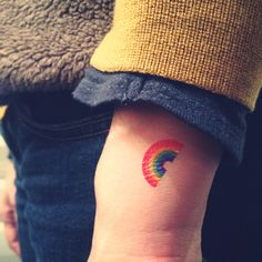 Tiny rainbow tattoo idea.