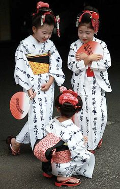 """This is another unique festival specially for ""topknot"" or ""chignon"". Once upon a time one lady in this region started using this special type hair style (seems to be normal for me), since then around 70 ladies including these girls make a procession with ""yukata""(an informal cotton kimono for the summer season)in the city on 19 Sept of her birthday. Before start procession they are very busy for chat.""  Photography and text  by Takero Kawabata on trek earth"