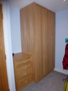 Oak wardrobes and chest of drawers