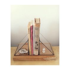 Hand cut and soldered, these bookends also double as small spaces to hold your precious things...