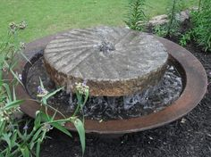 Millstones and syrup kettles for use in landscaping, gradens and architectural design