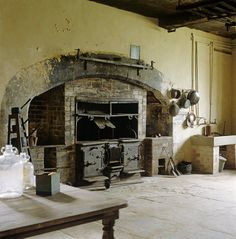 """The """"Eagle"""" cast-iron range in the Old Kitchen at Chastleton. It was installed for John H. Whitmore-Jones after he inherited the House in 1828. Various tools and utensils also in view."""