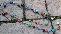 Colorful Beaded Knot Necklace by Vicki for Crafts Unleashed via FaveCrafts.com
