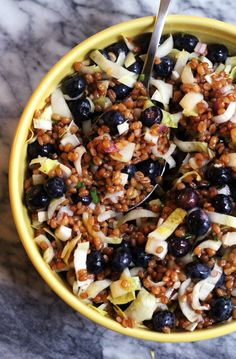 This wheat berry salad with blueberries and goat cheese is dressed in a champagne vinaigrette and makes for a hearty summer salad.