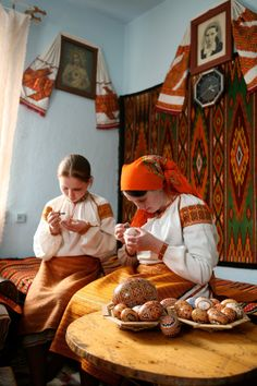 Wonderful Ukrainian artists. The villages where my parents come from were just like this. Embroideries everywhere in small hatas, black and white portraits on the walls, smell of wood and old things, lace on pillows
