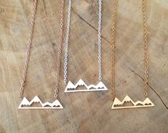 Dainty Delicate Mountain Top Necklace! Small snowy mountain top pendant on a delicate necklace.  ★ Material - Stainless Steel - With Silver, 18k Gold or 18k Rose Gold plating (select in drop-down menu) - Lead Free, Nickel Free & Titanium Free  ★ Measurements - Mountain top: 7 x 22 mm - Length: 42 cm + 5 cm extension chain (approx. 18.5) - If you wish to have the necklace shortened, please contact me!   PLEASE NOTE - Please be aware that the actual product might have slight variations in c...