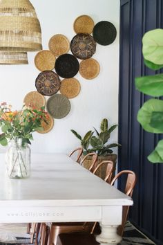 How to hang baskets on the wall to create a boho wall treatment. Thrift wicker plate holders then use finishing nails for a cheap boho wall! Basket Wall | DIY Basket Wall | Boho Basket Wall | Basket Wall On Wallpaper | Wallpaper | Wall Basket In The Nursery | How To Hang Baskets On The Wall | Hanging Baskets | How To Hang a Basket Wall | Basket Wall Nursery | Hanging Baskets in the Nursery | Hanging Baskets Nursery | Nursery Room | Baby Girl Nursery | Girl Nursery Room | Simple Basket Wall…