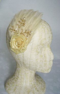 Organza rose and sequined spray on feather pad