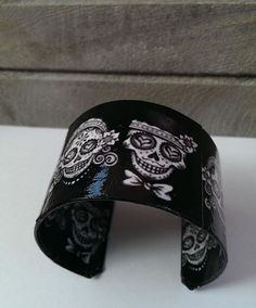 Day of the Dead Sugar Skull Cuff Decoupage Bracelet by BleedingHeartDesigns, $25.00 *would like to try with black leather and silver paint, on a sticker stencil