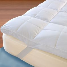 The Temperature Regulating Mattress Topper - no more hot flash sleeping issues...