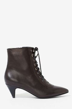Old fashioned period lace-up ladies booties.
