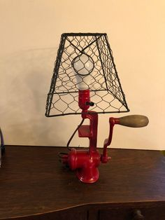 I have repurposed a meat grinder. I painted it red and made it into a lamp.