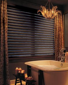 Cascading folds and a sheer outside view…how elegant for a bathroom––Pirouette® window shadings ♦ Hunter Douglas window treatments
