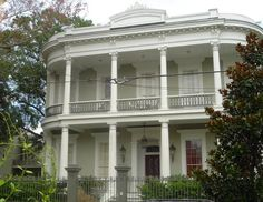 Lovely antebellum home in the garden district of New Orleans, with the unmistakable steamboat shape and double verandas.  Always best displayed in a setting full of shade trees.