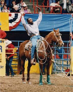 """How about this photo of Fred Whitfield """"raising the roof"""" from the 1997 NFR? That year, Whitfield would set tie-down roping history when he roped and tied 10 head in 84 seconds. A record that still stands."""