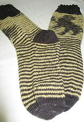 Ravelry: Hufflepuff Badger Shadow Socks pattern by Freshisle Fibers