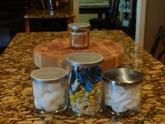 empty covered candle jars for, anything from cotton balls, cough drops, Q tips,...you get the idea...