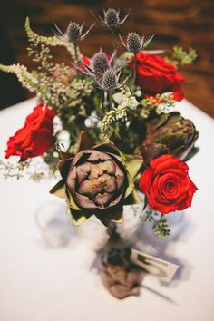 flower centerpiece with blue thistle + pops of red // photo by Elle Golden Photography // View more: http://ruffledblog.com/the-notwedding-athens/