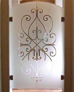 etched glass doors all glass frameless wrought iron motif