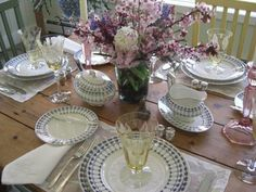On a Spring table, a mix of Swedish dishes, American crystal, Venetian linens and flea-market silver.