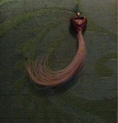 A curl of hair from the Earl of Essex, made into an earring after his execution