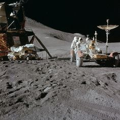 Apollo 15 astronaut Jim Irwin working on the lunar rover