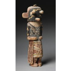 A HOPI POLYCHROME WOOD KACHINA DOLL possibly depicting Paaloloqang, or water serpent, standing on slightly bent knees, the black case mask with pop eyes and tubular snout, painted with three spotted serpents.  height 11 1/2 in.