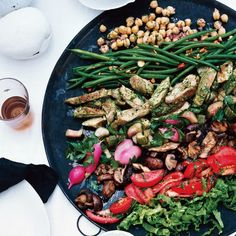 """""""I like my salads to be meals,"""" says food editor Gina Marie Miraglia Eriquez, who developed these recipes. """"Lots of fresh everything.""""          The many components of this big salad—served side by side on a platter—all have quite different flavors and textures, which, as they get mixed up on your plate, go together brilliantly."""