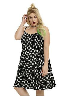 "<p>This is it: the ultimate 90s dress! This black babydoll dress features an all-over white daisy print, adjustable spaghetti straps and a side zipper. Throw on your combat boots and a denim jacket and you're ready for a casual day to night look! </p>  <ul> 	<li>100% rayon</li> 	<li>Wash cold; dry low</li> 	<li>Model is wearing size 14</li> 	<li>38"" from shoulder to hem</li> 	<li>Imported</li> </ul>"