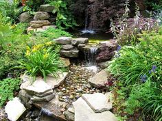 In this stunning natural rock garden idea, water garden elements are combined with plants and a natural rock garden.