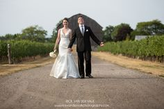 Portrait of Bride and Groom taking a walk after ceremony at Cave Springs Winery.