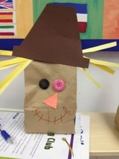 Cute for Scarecrow week: have them paint bags first (mouth), then glue on buttons and hair and nose and finally the hat
