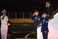 U.S. President Barack Obama (R) arrives at Joint Base Pearl Harbor-Hickam on January 2, 2013 in Honolulu, Hawaii. The president returned to Hawaii for his family vacation after coming back to Washington, DC during his holiday to work on the 'fiscal cliff' issue