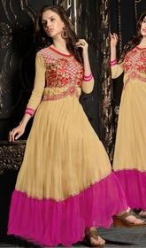 Beige and Pink Color Net Embroidered Gown #indianweddinggown #flaredgowns Garner compliments wherever you go wearing this beige and pink color net embroidered gown. The attractive crystals, resham and stones work a significant feature of this gown.  USD $ 69 (Around £ 48 & Euro 52)