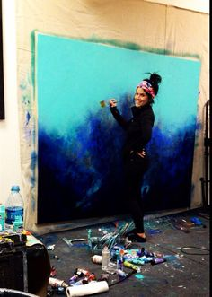 Brittany Lee Howard painting in the studio