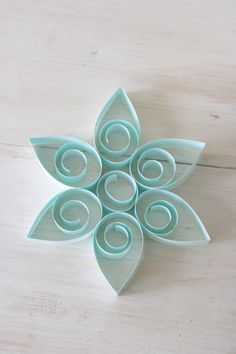 A fun and easy Hanukkah craft project involving a process of paper scroll work called quilling.