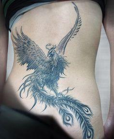 Phoenix tatouage bas du dos femme