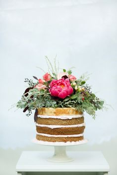I love this #wedding cake with beautiful, bright flowers! From http://loveandlavender.com/2014/02/romantic-mountain-vow-renewal/  Cake by http://chantillypastry.com/  Photo Credit: http://amberlynnn.wix.com/photography