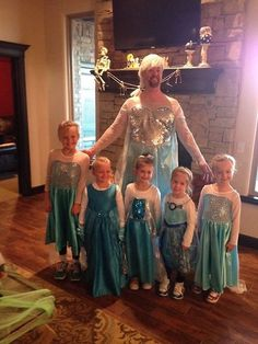 Father of the Year! All his daughters wanted to go as Elsa from Frozen, so he did too! Give this man a trophy!!
