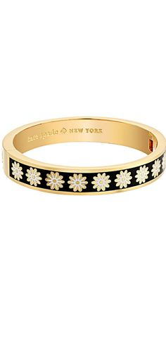 A bouquet of beauty!  Pluck pretty pleasures adorned with the Kate Spade Oops A Daisy Hinged Idiom #Bracelet. #jewelry #katespadeny